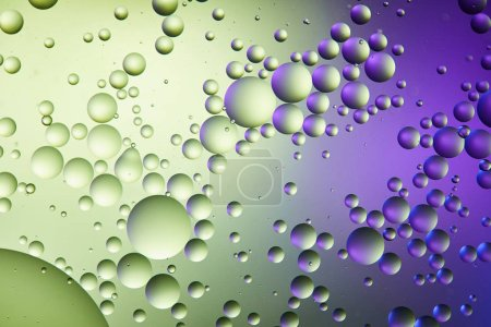 purple and green color abstract background from mixed water and oil bubbles