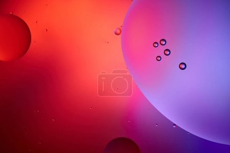 pink and purple color abstract background from mixed water and oil bubbles
