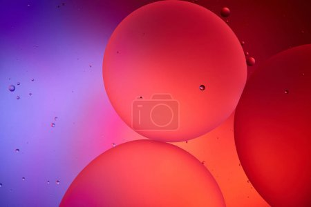 Beautiful abstract background from mixed water and oil bubbles in pink and purple color