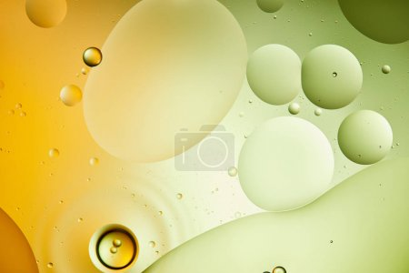 Photo for Beautiful abstract background from mixed water and oil in green and orange color - Royalty Free Image