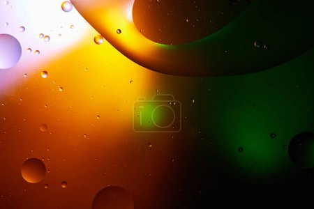 Photo for Beautiful abstract background from mixed water and oil in orange, green and purple color - Royalty Free Image