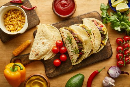 Photo for Top view of tacos with meat and fresh ingredients on wooden table - Royalty Free Image