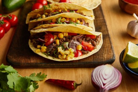 Photo for Traditional mexican tacos with ripe vegetables on wooden table - Royalty Free Image