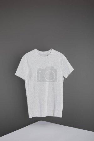 Photo for Blank basic light grey t-shirt on grey background - Royalty Free Image