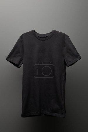 blank basic black t-shirt on grey background