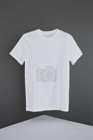 blank basic white t-shirt on grey background