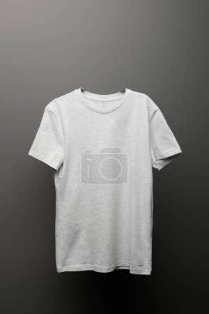 Photo for Blank basic light grey t-shirt on grey background - Royalty Free Image