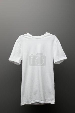 Photo for Blank basic white t-shirt on grey background - Royalty Free Image