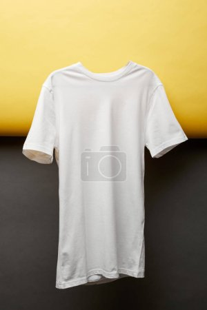 blank basic white t-shirt on black and yellow background