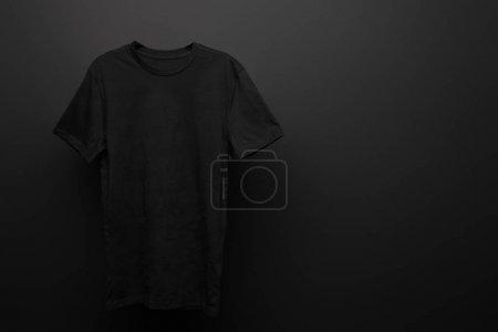 Photo for Blank basic black t-shirt on black background - Royalty Free Image