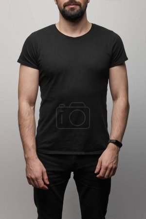 Photo for Cropped view of bearded man in blank basic black t-shirt on grey background - Royalty Free Image