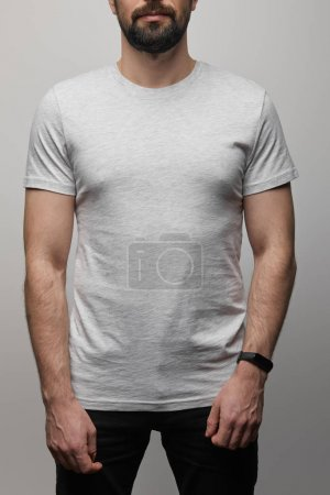 Photo for Cropped view of bearded man in blank basic grey t-shirt isolated on grey - Royalty Free Image