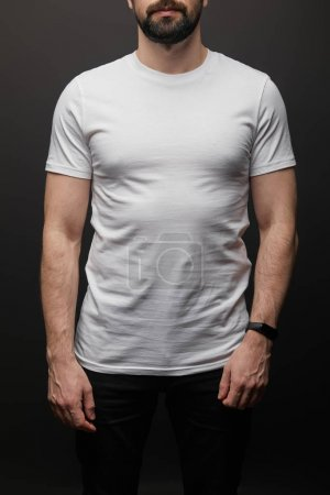 Photo for Cropped view of bearded man in blank basic white t-shirt isolated on black - Royalty Free Image