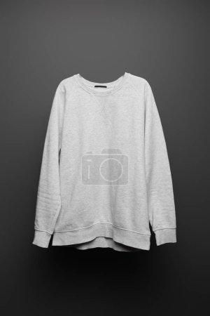 Photo for Blank basic grey sweatshirt on black background - Royalty Free Image