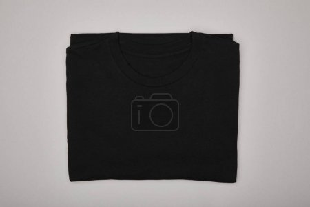 Photo for Top view of blank basic black t-shirt isolated on grey - Royalty Free Image