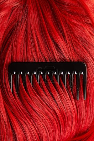 Top view of comb on colored red hair