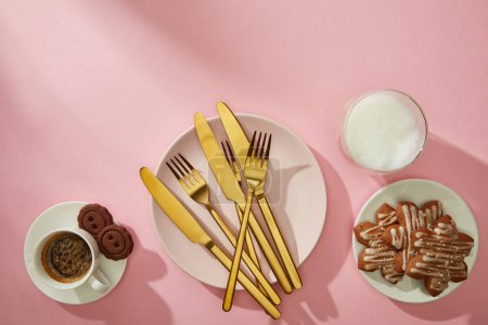 Top view of tasty cookies with milk and coffee on pink background