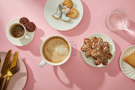 Photo for Top view of cups of coffee with fresh cookies and water on pink background - Royalty Free Image