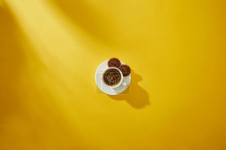 Photo for Top view of tasty cookies on saucer of coffee cup on yellow background - Royalty Free Image