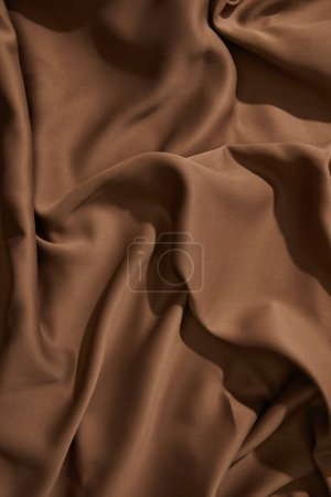 Photo for Top view of brown wavy tablecloth - Royalty Free Image