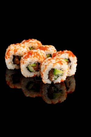 Photo for Delicious California roll with avocado, salmon and masago caviar isolated on black - Royalty Free Image