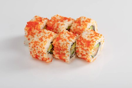 Photo for Delicious California roll with avocado, salmon and masago caviar on white surface - Royalty Free Image