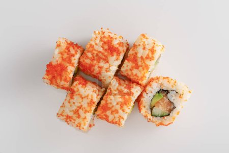 Photo for Top view of delicious California roll with avocado, salmon and masago caviar on white surface - Royalty Free Image
