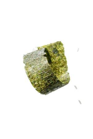 Foto de Vista superior de la pieza retorcida de algas nori y el arroz aislado en blanco - Imagen libre de derechos