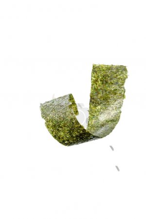 Photo for Top view of twisted nori seaweed piece and rice isolated on white - Royalty Free Image
