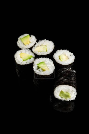 Photo for Delicious sushi maki with avocado isolated on black - Royalty Free Image