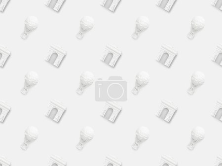 top view of small arc de triomphe and air balloons figurines isolated on white