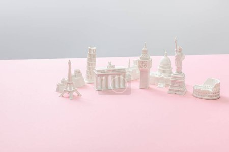 Photo pour Souvenirs from different countries on grey and pink - image libre de droit