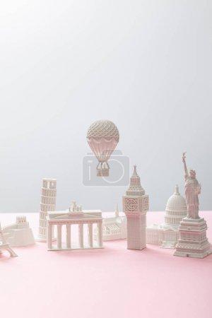 Photo pour Little souvenirs from different countries on grey and pink - image libre de droit