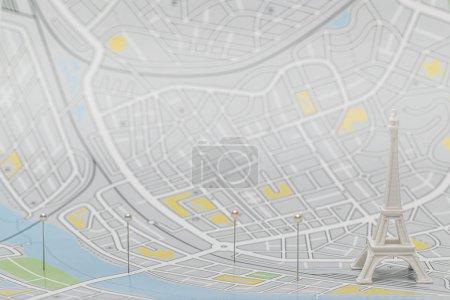Photo pour Foyer sélectif des broches près de la petite statuette tour eiffel sur la carte de paris - image libre de droit