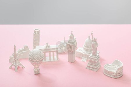 figurines from countries on pink and grey