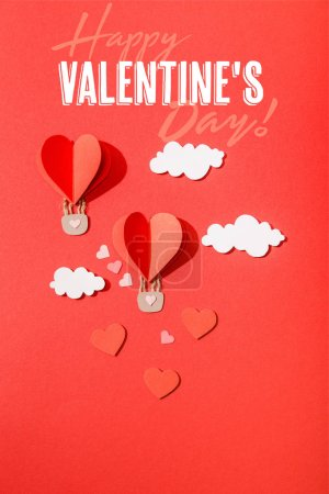 Photo for Top view of paper heart shaped air balloons in clouds near happy valentines day lettering on red background - Royalty Free Image