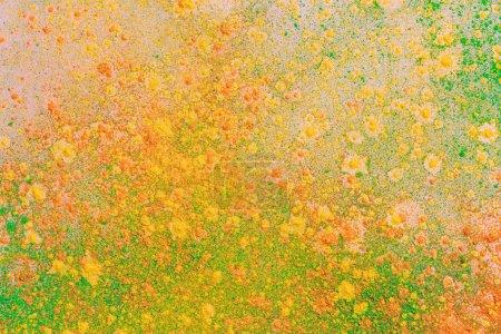 Photo pour Explosion de peinture orange, jaune et verte colorée holi - image libre de droit