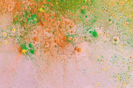 Photo for Orange, yellow and green colorful holi paint explosion - Royalty Free Image