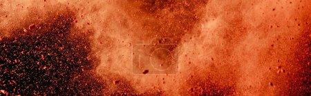 Photo pour Peinture holi orange colorée explosion sur fond noir, photo panoramique - image libre de droit