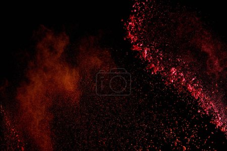Photo for Red colorful holi paint explosion on black background - Royalty Free Image