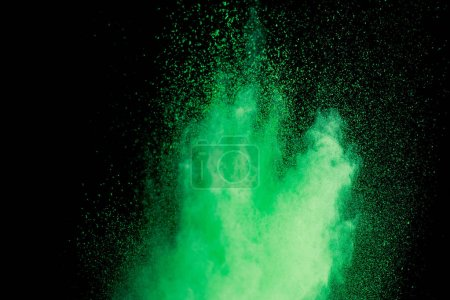 Photo for Green colorful holi paint explosion on black background - Royalty Free Image
