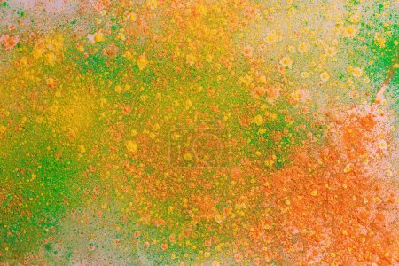 Photo for Yellow, green and orange colorful holi paint explosion - Royalty Free Image