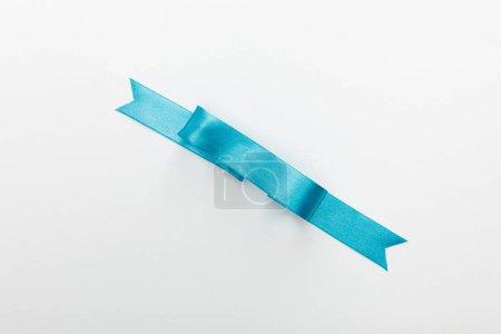 Photo pour Vue du haut du ruban décoratif bleu satin isolé sur blanc - image libre de droit