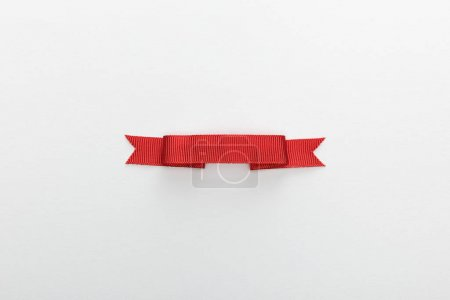 top view of red decorative ribbon isolated on white
