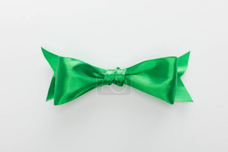 top view of satin green bow isolated on white