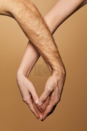 cropped view of man and woman touching hands isolated on beige