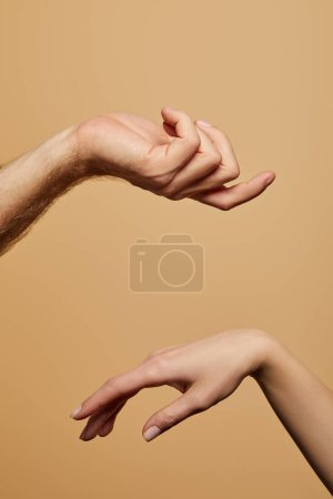 Photo for Cropped view of man and woman gesturing isolated on beige - Royalty Free Image
