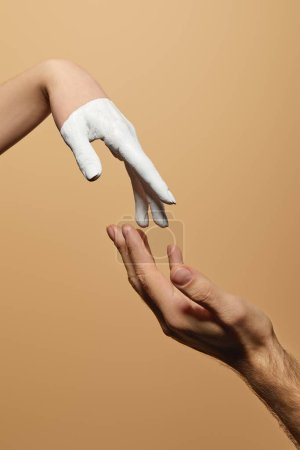 Photo for Cropped view of man and woman with painted hand touching each other isolated on beige - Royalty Free Image