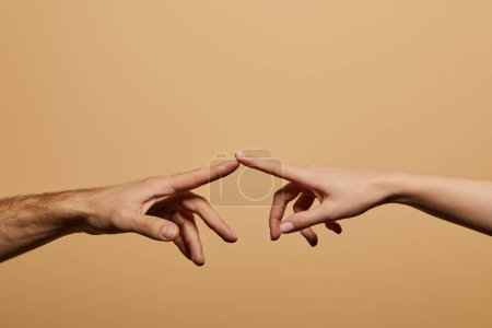 Photo for Cropped view of man and woman touching with fingers isolated on beige - Royalty Free Image