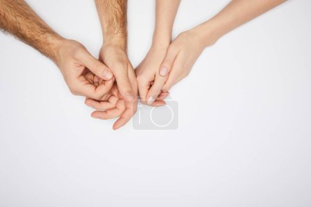 Photo for Top view of male and female hands isolated on white - Royalty Free Image